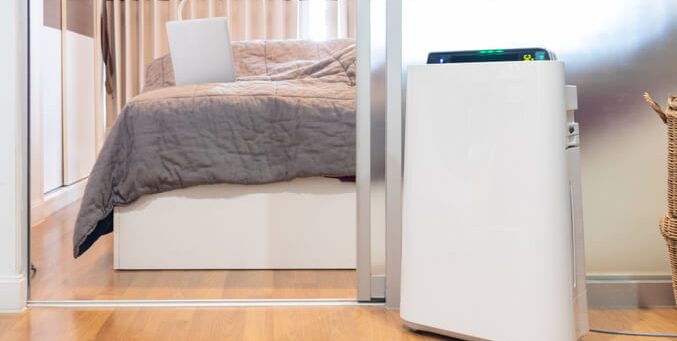 Where should an air purifier be placed in a bedroom